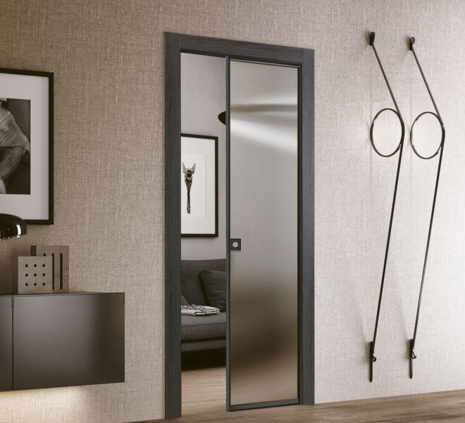 porte-scorrevoli-plana-effetto-legno-grafite-glass-vetro-trsparente-grigio